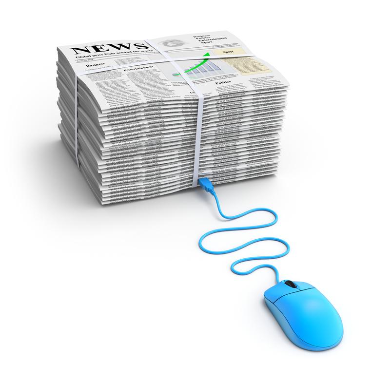 תמונה של עיתונים עם עכבר של מחשב